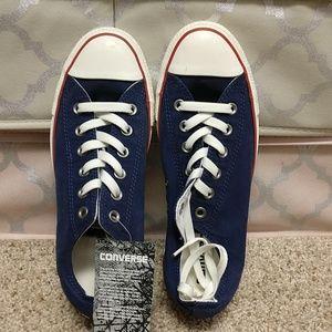 NWT blue Converse shoes.